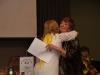 Julie gives Enid a hug